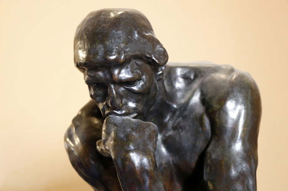 A sculpture of a man thinking deeply